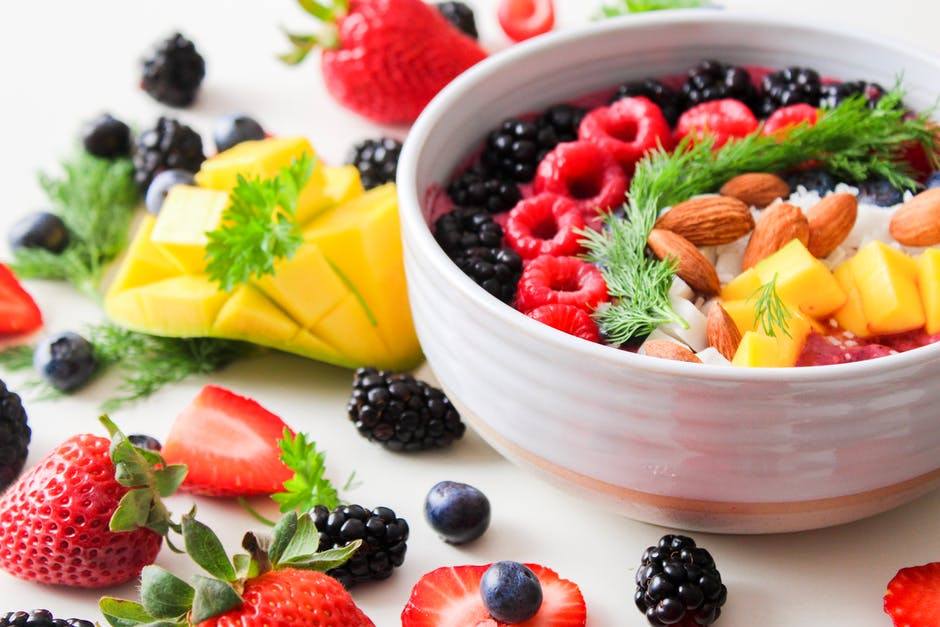 A bowl of fruit salad on a plate